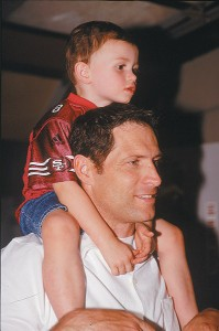 Braedon, age 2 1/2, is happy no matter where they are — if he's on dad's shoulders.