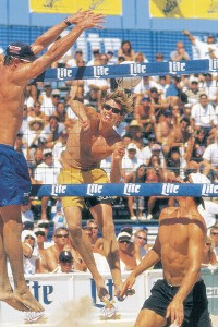 "This photo of Troy Tanner was printed in the 1997 ESPN calendar, with the likes of tennis ace Pete Sampras, golf pro Phil Mickelson and shortstop Omar Vizquel. His scrapbooking wife, Desiree, has the calendar mounted in a family scrapbook under the headline ""Calendar Boy."" Troy also did a Sunkist commercial during his prime pro-volleyball career."