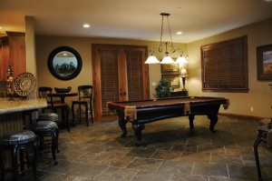 "POOL TABLE After refinishing the top of their pool table in matching black velvet, the Burrows incorporated the pool table into the main living area of their Woodland Hills home. The family's goal was to create the perfect ""Friday night"" location."