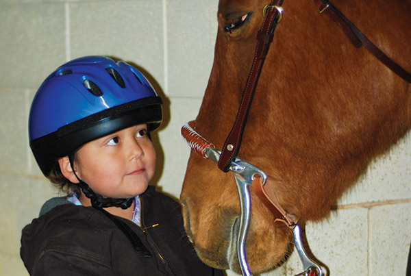 """To grant Myshayla Atene's wish, the Make-A-Wish Foundation of Utah, along with Courage Reins Therapeutic Riding Center in Highland, helped Myshayla choose everything she'd need for riding lessons: a saddle, bridle, saddle blanket, brushes, horse treats, blue jeans and riding shirt from a local C-A-L Ranch store. Myshayla works with """"her"""" horse, Pepe, during weekly lessons. """"All the people who watch her say she's graceful and has a natural balance,"""" mom Andrea says. """"It's the one day each week she's excited to get out of bed."""""""