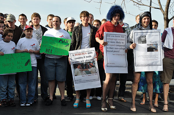 """Men are invited to """"walk the walk"""" by teetering down a one-mile course to raise money and awareness to stop rape, sexual assault and gender violence."""