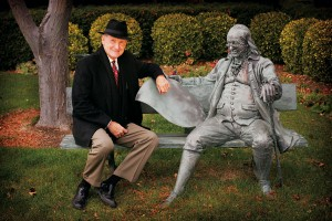 Hyrum Smith and Ben Franklin share a bench at the Franklin Covey headquarters in Salt Lake City.