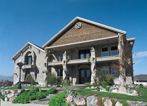 "The ""Gargoyle House"" in Spanish Fork is well-known to many in the south end of the valley. The twisted brick columns and the European influence reflect the individuality of owners Brandon and Nikki Thomas.The 6,500 square foot home sits on a one-third acre lot."