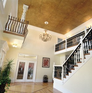 "The front room of the Spanish Fork home is open to the second story. Nikki didn't want ordinary spindles for her banister. ""So Brandon came up with this original design with iron,"" she says.The gold ceiling is created with wallpaper.The double glass doors open into a home office.The bedrooms are located on the second story."