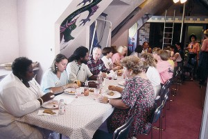 The Timpanogos Storytelling Festival was held at the Ashton's Orem home for the first few years. Here are the storytellers enjoying lunch with the volunteers in the Ashton's upstairs playroom.