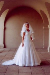 This modest bridal gown, with the popular capped sleeves, is one of the many mix and match choices at Gowns by Pamela.