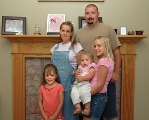 Star Quayle, shown here with her husband and three children, lost a baby but has given birth to a community tradition.