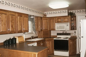 AFTER The Ott family in Orem redid their kitchen, windows, doors and floors to update their 26-year-old home. They say the key to easy remodeling is finding workers who will stick to a schedule.