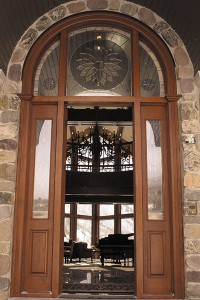 The round glasswork above the entryway to the Hobblecreek home of Bill and Margaret Pope was originally made as a spare for the San Diego Temple. When none of the 24 circles used in the temple broke, the glassmaker sold the extra piece to the Popes.