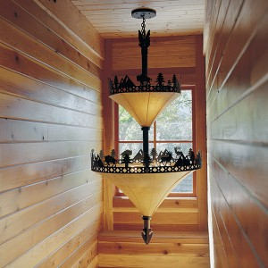 this handsome light from Ironwood Industries adds style and substance to the stairway leading from the main floor to the second floor of the cabin.