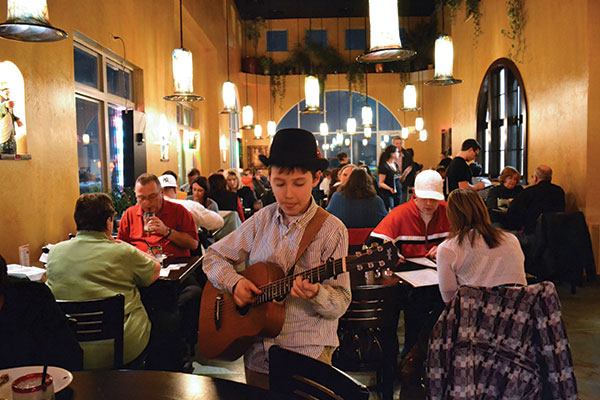 Weekend diners at Milagros are often serenaded by the son of the owner, Dave Tuomisto. The unique lighting fixtures at this Orem hotspot were created by local artist Tom Holdman. The Spanish decor includes live plants growing above the double-story dining room.