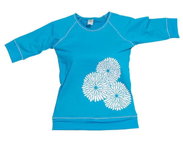 Say no to chafing with this teal rash guard with white mum applique. It's great as a cover-up, and the matching pull-on skirt is perfect for playing in the sun.
