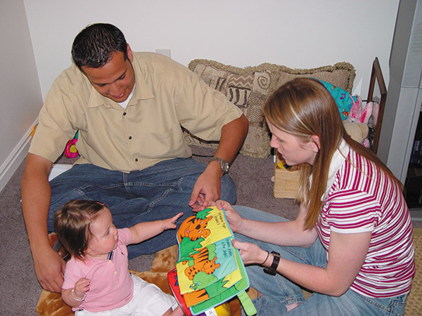 Susanna Johnson, a volunteer for Welcome Baby, assists families like the Jaramillo family of Lehi adjust to a new baby.