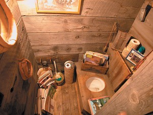 This outhouse with indoor plumbing is a hit with visitors and family. The John Wayne Toilet Paper adds the finishing touch.