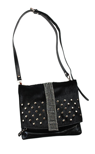6. DX Touch Handbag This rock meets glam handbag by DX Touch takes things up a notch with crystals and studs. Wear this fashion forward bag with confidence.  Available at The Veranda.