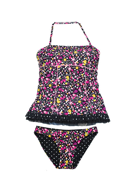 Suit yourself pretty this summer with this reversible tankini by gossip girl.