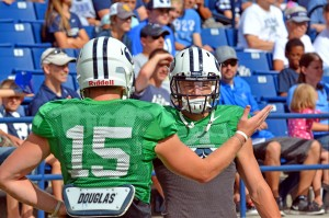 Quarterbacks Ammon Olsen (#15) and Taysom Hill celebrate at the scrimmage Saturday.