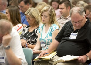 Attendees at the 2012 Education Week take notes in one of the classes. This year there will be over 1,000 classes offered.(Photo courtesy of BYU Photo)