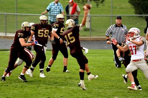 Chandler Clark (#70), Danielson Auelua (#58) and Hunter Apostolos (#55) watch Gajkowski release a pass Friday night.