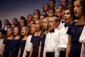 Children from East Valley Millennial Choirs & Orchestras, a sister organization to UVMCO, sing in concert at the Mesa Arts Center in Mesa, Ariz., in 2010.