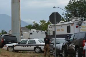 A Provo fireman makes a call after a man was taken into custody Friday afternoon. (Photo by Rebecca Lane)