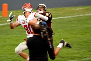 Bountiful receiver Tanner Redding is defended by Lone Peak's Seth Hannemann.