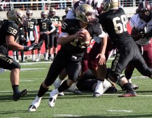 Baron Gajkowski, the Lone Peak quarterback, is a dynamic runner and passing threat. (Photo by Kurt Johnson)