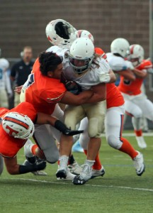 Timpview defensive end Isaiah Nacua (7) is a big hitter and one of the state's top recruits. (Photo by Margaret Lindsay)