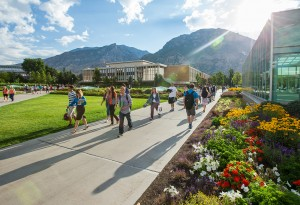 BYU students walk on campus near the Harold B. Lee Library. BYU expects to have a 10 percent enrollment drop from Fall 2012 to Fall 2013. (Photo by Jaren Wilkey/BYU Photo)