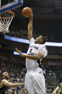 Brandon Davies dunks the ball in a BYU basketball game. Davies signed with the Philadelphia 79ers out of college.  (Photo by BYU Photo)