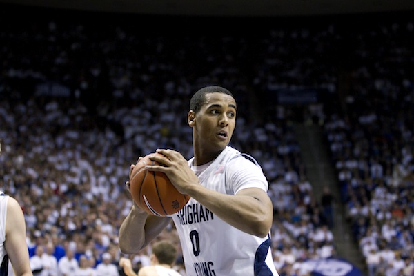 Brandon Davies grips the ball in a BYU basketball game. Davies signed with the Philadelphia 76ers Monday morning. (Photo by Jaren Wilkey/BYU)