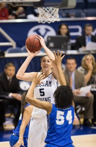 Jennifer Hamson shoots the ball over a defenders outstretched arms. (Photo courtesy of BYU Photo)