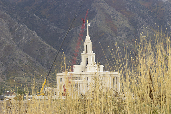 The angel Moroni is placed on top of the Payson temple Thursday. The Payson temple is one of 15 temples under construction.