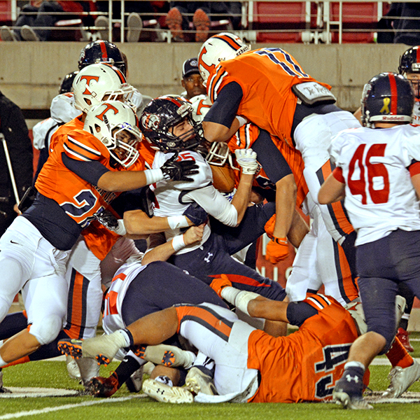 Emmett Tela (#43), Tyus Moe (#17), Will Watanabe (#24),Tegan Christianson (#6) and other Timpview Thunderbirds gangtackle a Woods Cross runner.
