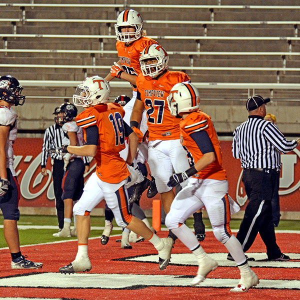 Knight Woodward (#85), Rhett VanLeeuwen (#19), Mitchell Stephenson (#15) celebrate a touchdown by Kendall Tu'ua (#27).