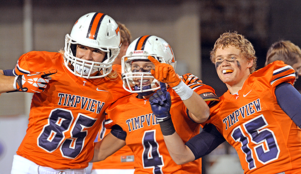 Knight Woodward (#85), Porter Case (#4) and Mitchell Stephenson (#15) celebrate with Timpview fans after the game.
