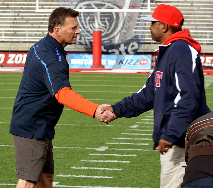 Coach Whittingham shakes hands with East head coach Brandon Matich.