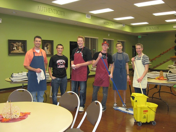 Volunteers for the Food and Care Coalition's Thanksgiving dinner help clean up after the meal. (Photo courtesy Food & Care Coalition)
