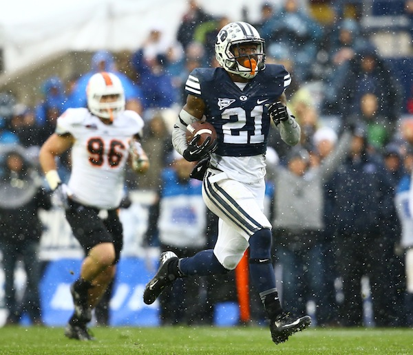 Jamaal Williams runs the ball up the field in Saturday's game against Idaho State. Williams ran for (Photo courtesy BYU Photo)