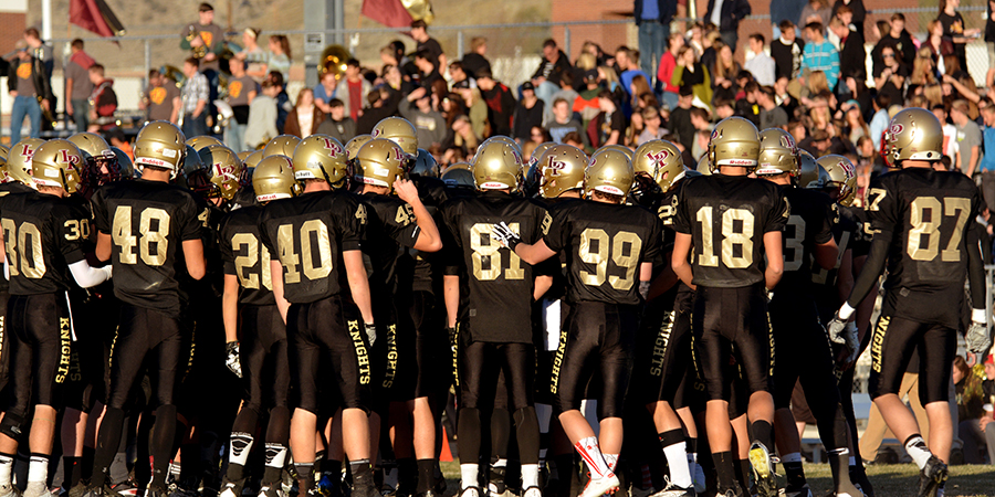 The Lone Peak Knights huddle before starting the second half Friday night at Lone Peak High School.