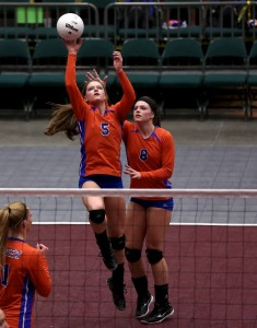 Lyndie (5) and Lacy (8) Haddock on the court during a volleyball state semifinal. Photo by Shane Marshall