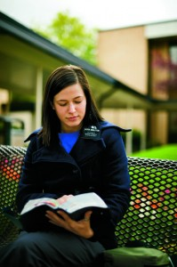 An LDS sister missionary studies her scriptures outside at the Provo Missionary Training Center. (Photo courtesy LDS Church)