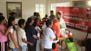 Alagang Kapatid Foundation, a partner with LDS Charities in many humanitarian projects, visited and helped serve the evacuees at the meetinghouse in Matnog, Sorsogon. (Photo courtesy Mormon Newsroom)