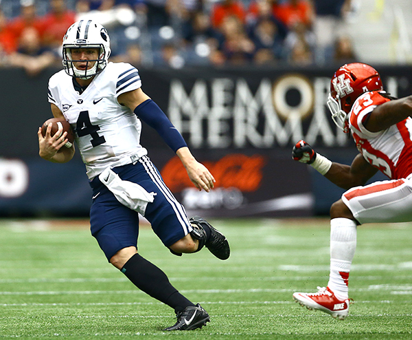 Best individual performance: Taysom Hill completed 29 of 44 passes for 417 yards and four touchdowns (including this hook up with Ridley) against the Houston Cougars. (Photo by BYU Photo)