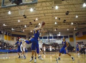Orem's Dalton Nixon rebounds during a game against Lone Peak. (Photo by Rebecca Lane)