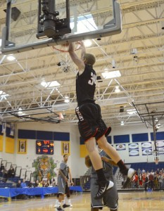 American Fork's Tyler Rawson dunks the ball during a game in the Great Western Shootout. (Photo by Rebecca Lane)