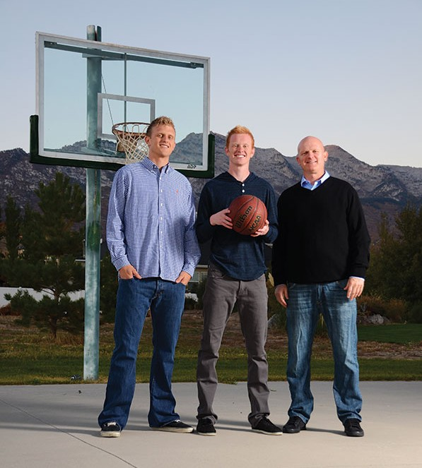 BYU's past (Marty, right), present (Tyler, left) and future (T.J., middle) are all represented on the Haws family backyard basketball court in Alpine. (Photo by Leah Aldous/Utah Valley Magazine)