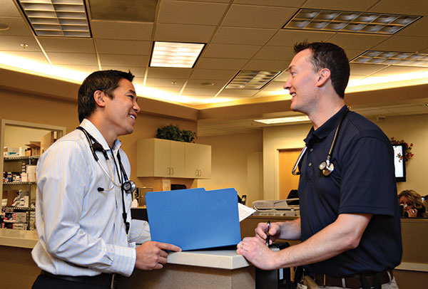 Skilled InstaCare clinic physicians like Dr. Jordan Inouye (left) and Dr. Mark Wardle assist patients in urgent need, then get them back to their primary-care providers. (Photo courtesy of