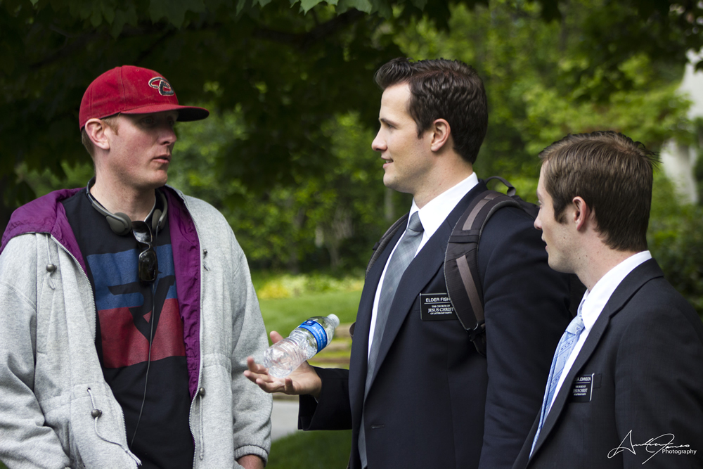 """Director Adam White (left) talks with David Lassetter (center) and Dashiell Wolf on the set of """"Inspired Guns."""""""
