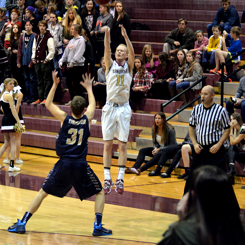 TJ Haws makes a 3-point shot during the first half of the Lone Peak win.